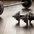 25127077 - dumbells for fitness on wooden floor with empty space